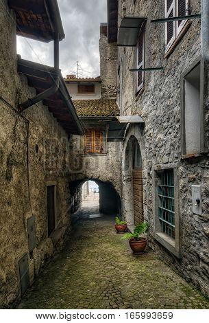 Narrow street in Riva di Solto next to Iseo Lake Italy