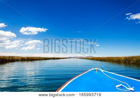 Front of a boat passing through a canal on Lake Titicaca in Peru