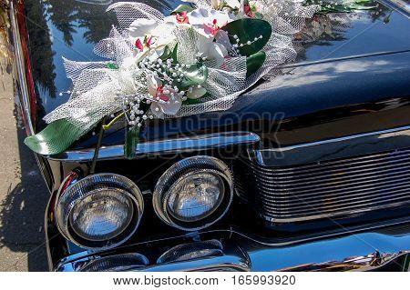 A wedding flowers on a car bonnet