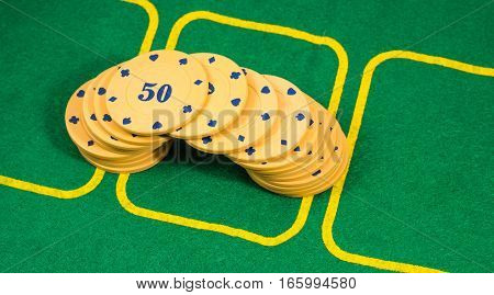 poker chips lined the bridge in the background a green leaf