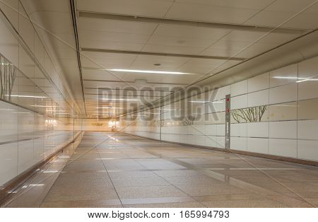 Perspective of Empty underground passage at night