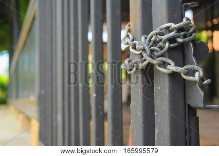 Grille doors were closed and padlocked with chains.