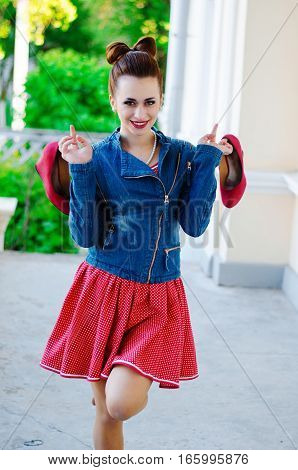 Portrait Of Young Pinup Girl Wearing At Retro Vintage Old-fashioned Dress In Peas, Jeans Jacket, Ret