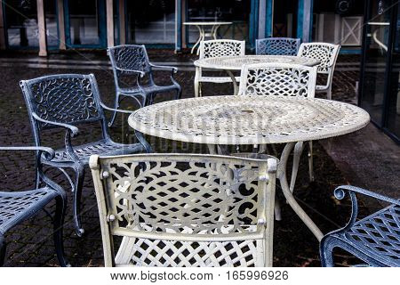 Empty Metal Tables And Chairs In A Street Cafe In The Fall.