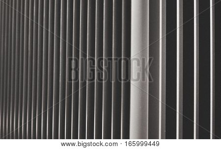 Array of steel fin edges at the corner of a building
