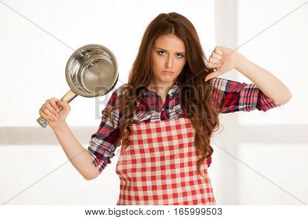 Beautiful Woman Hate Cooking Showing Thumb Down