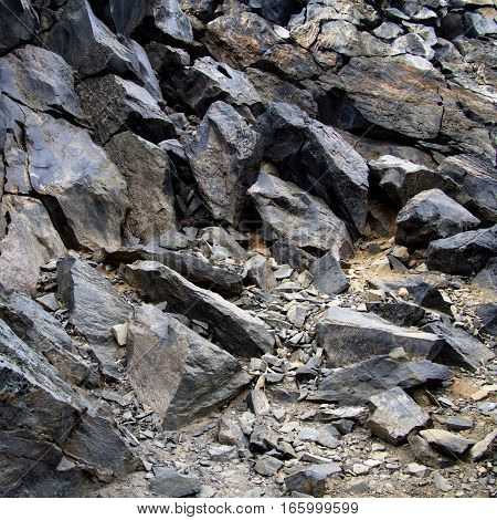 The bottom of a jagged hill at the Big Obsidian Flow in the Newberry National Volcanic Monument in Central Oregon.