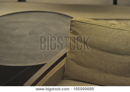 Close up shot of an armchair and center piece