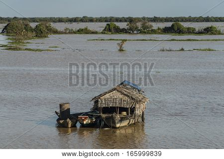 Boats and cottage near Tonle Sap lake in Cambodia
