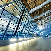 night scene of Shanghai's Pudong International Airport Terminal t2. poster