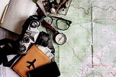 wanderlust and adventure concept compass camera phone passport money notebook on map top view space for text vintage toned image poster