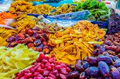 The sweet dried fruits in the stall of Carmel market Tel Aviv Israel. poster