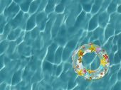 Top view of inner tube floating on sunbathed swimming pool - high resolution large file poster