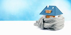 home insulation concept. house with scarf around