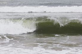 Closeup image of a waves about to crash.