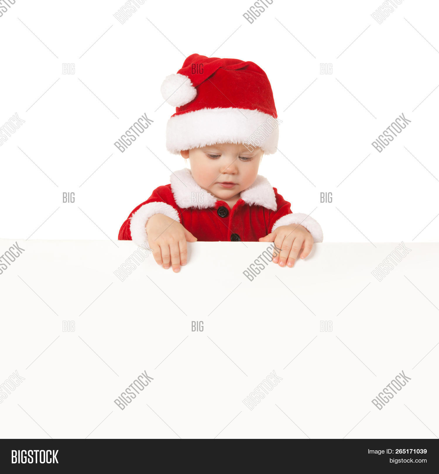1211d465944 Happy santa baby with white blank board isolated on white. Small model in santa  hat