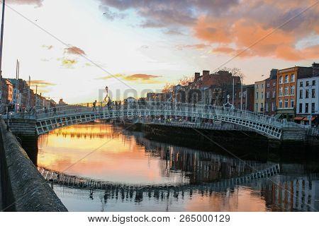 Dublin Night Scene With Hapenny Bridge And Liffey River Lights