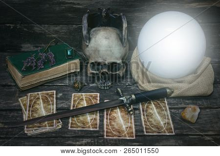 Tarot Cards And Crystal Ball On Fortune Teller Desk Table Background. Futune Reading Concept. Divina