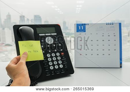 Close Up Businesswoman Put Postit Of Call Me Back On Colleague Ip Phone