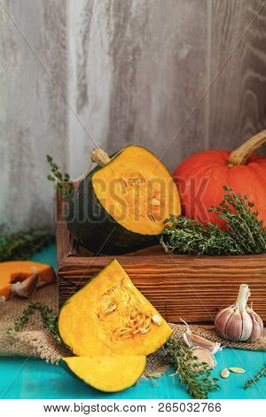 Green And Orange Pumpkin, Ingredients For Tasty Vegetarian Cooking On Light Wooden Surface, Food Art