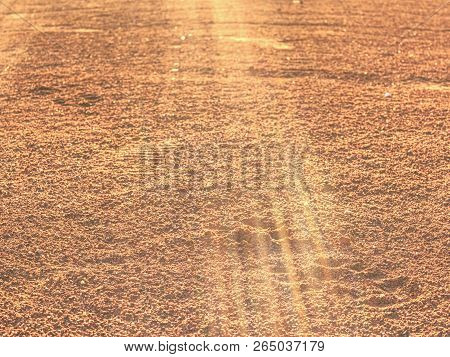 Red Clay Court Trampled Pattern By Tennis Player And Serviceman Footprints.  Marks On A Outside Tenn