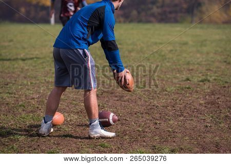 american football kicker practicing football kickoff closeup shot