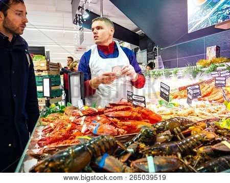 Strasbourg, France - Dec 30, 2018: French Fisherman In Supermarket Selling Fresh Ocean And Sea Fish