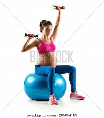Pregnant Woman Exercising On Gymnastic Ball With Dumbbells Isolated On White Background. Concept Of