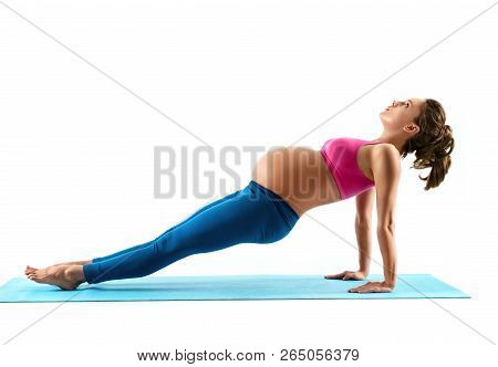 Young Beautiful Pregnant Woman Does Yoga Exercise On Last Months Of Pregnancy Isolated On White Back