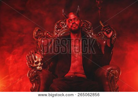 A portrait of a bad demon in his throne. Horror movie, nightmare. Halloween. poster