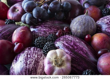 Background Of Fresh Vegetables And Fruits. Purple Eggplant, Blackberries, Plums, Grapes, Figs, Apple