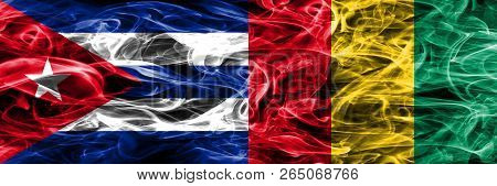 Cuba, Cuban Vs Guinea, Guinean Smoke Flags Placed Side By Side. Concept And Idea Flags Mix