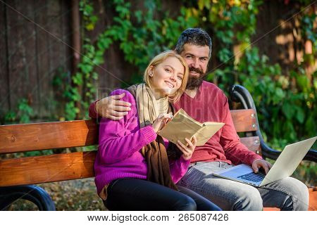Couple With Book And Laptop Search Information. Share Or Exchange Information Knowledge. Information