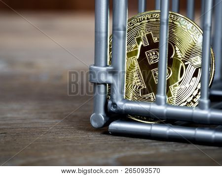 The coin is in the gray nick color put on a wooden table. The concept of investment and fluctuation of bitcoin and cryptocurrency. poster