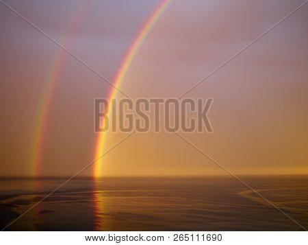 Dramatic Majestic Rainbow Over Tropical Sea Ocean And Sky Costa Blanca Spain