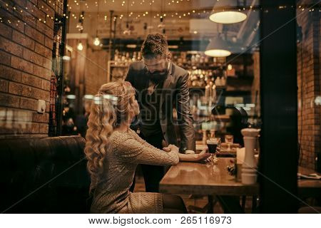 Date Of Family Couple In Romantic Relations, Love. Couple In Love Meet At Restaurant. Business Meeti