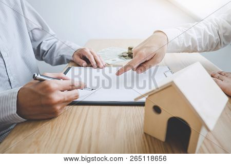 Business Signing And Analyzing A Contract Buy - Sell House, Insurance Agent Analyzing Cost About Hom