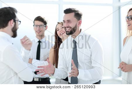 business colleagues discussing new ideas while standing in the o