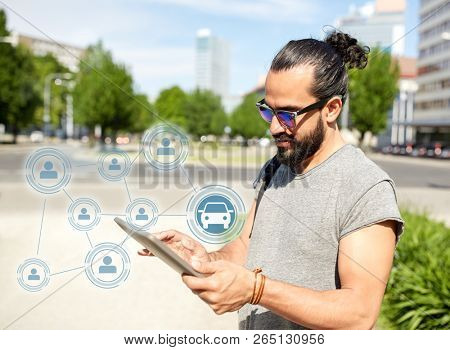 travel, car sharing and modern technology concept - man traveling tablet pc computer in city searching location