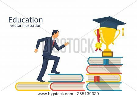 Education Ladder Concept. Young Man Goes To The Top Of The Piles Of Books. Cup With An Academic Cap