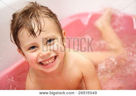 Happy Child Bathes In A Bathroom