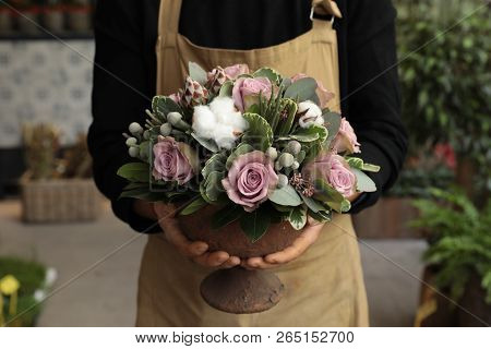 Festive Flower Arrangement Of Paleviolet Roses And Cotton Flowers In The Vase Florist Holding At The