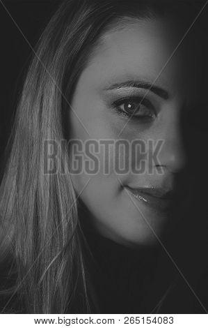 Beautiful Woman Emotional Portrait Taken In Low Light Artistic Conversion