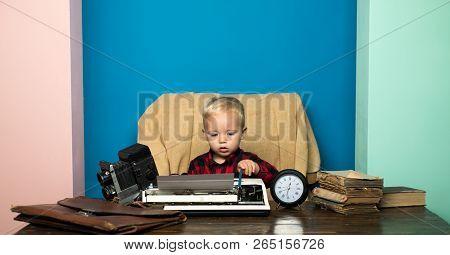 Boy Typewrite Special Report On Vintage Typewriter. Little Photojournalist Work On Written Report At