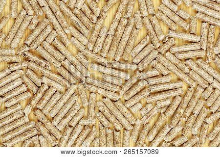 Wood Pellets On Wooden Surface, Alternative Heating