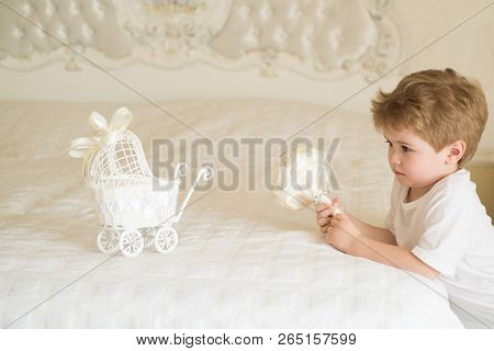 Free Hair. Small Child With Stylish Haircut. Small Boy With Blond Hair In Bedroom. Little Child With