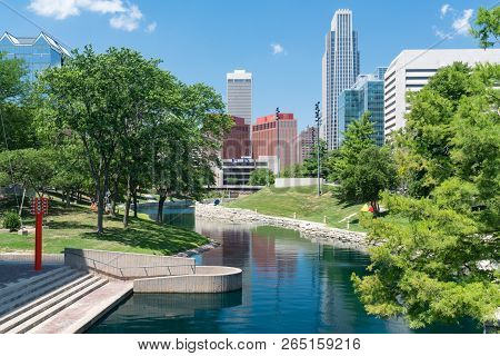 City Skyline In Downtown Omaha, Nebraska Along The Gene Leahy Mall