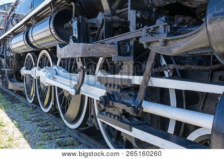 Iron Wheels Of Old Steam Railroad Locomotive