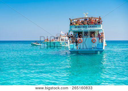 Ayia Napa, Cyprus - July 23, 2017: A Boat With Tourists Sails Along The Coast.