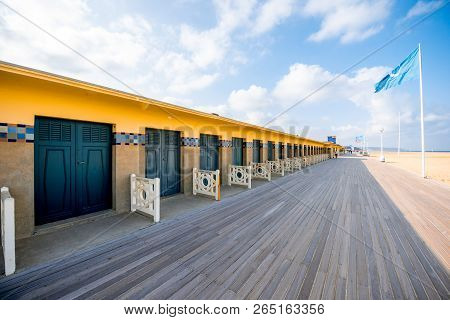 Deauville, France - September 06, 2017: Landscape View Of The Beach With Famous Locker Rooms Dedicat